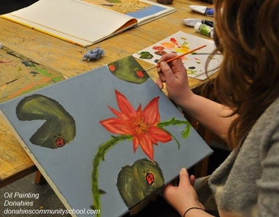 Woman painting at Adult Education course