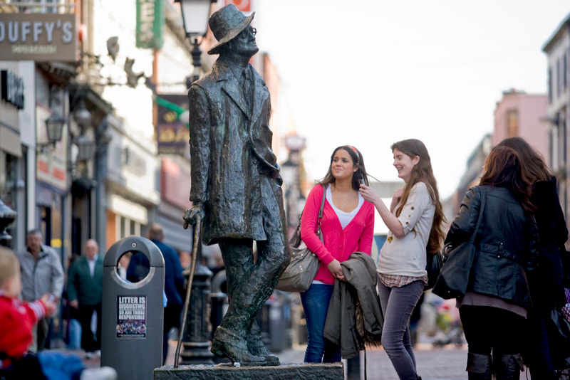 Posing for photographs at the James Joyce statue in Dublin